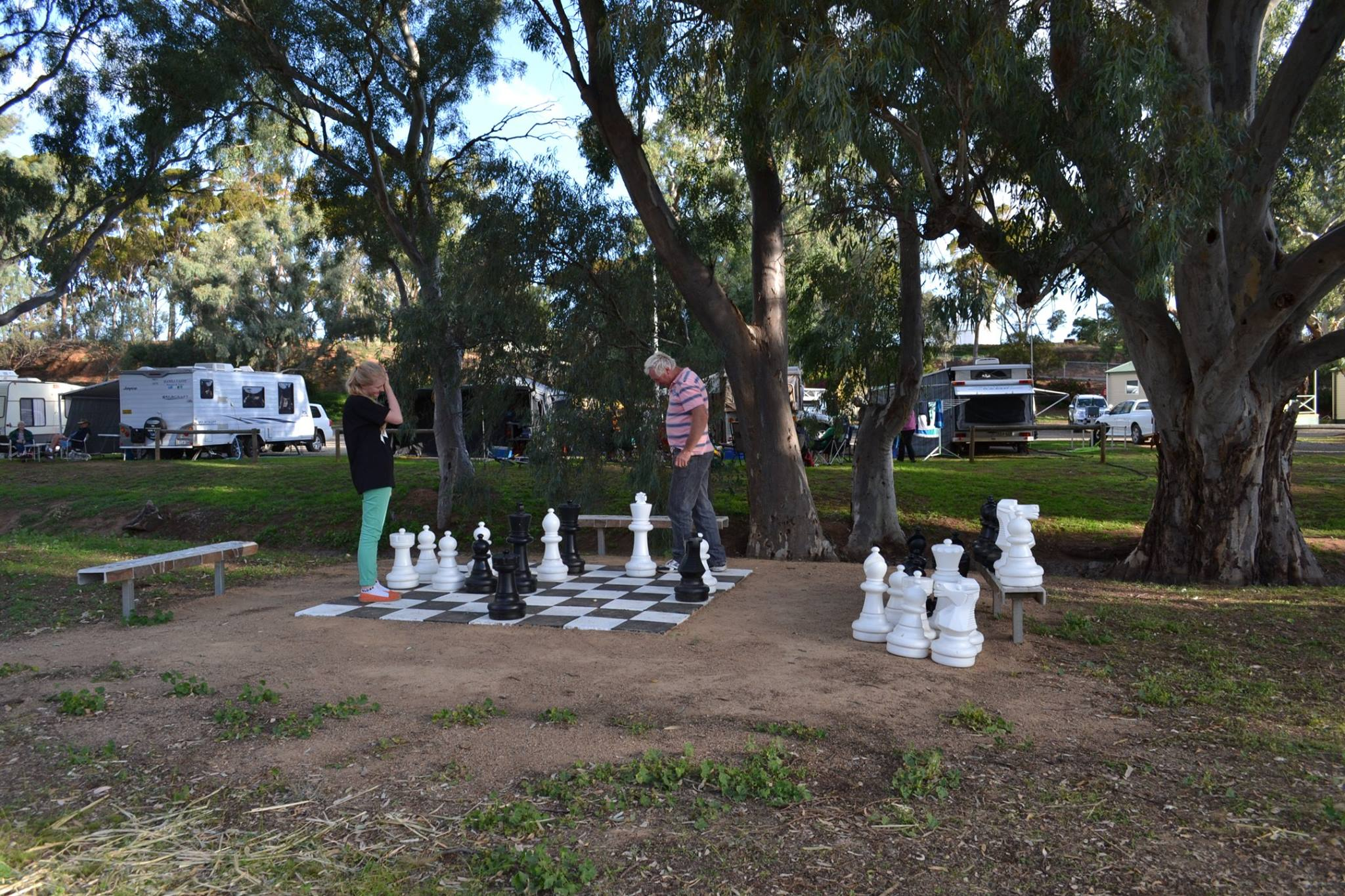 People playing a giant game of chess